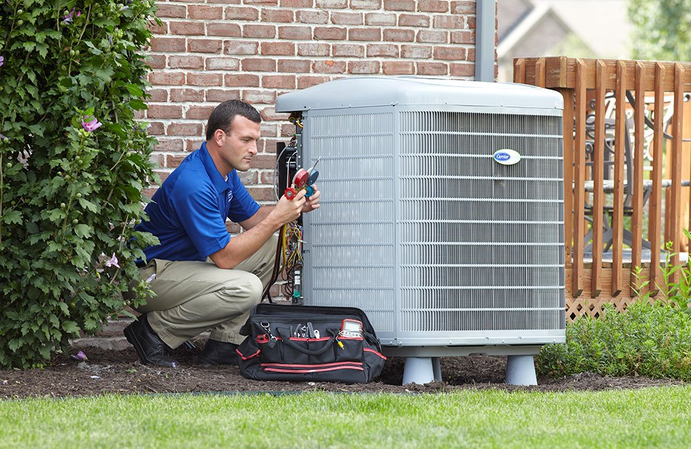 AC technician in Jacksonville repairing an AC unit