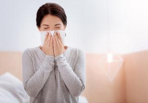 woman with allergies from her home